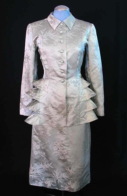 Silver, ruffled silk suit, circa 1940s