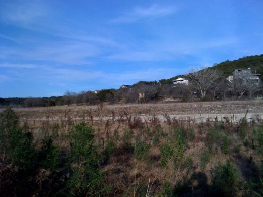 Lots of dry lake land where Lake Travis once was.