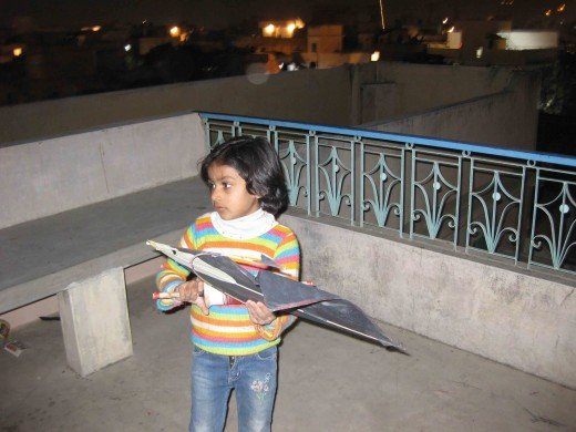 Child in Jaipur trying to fly kite