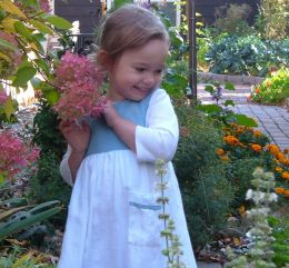 A child enjoying the flowers. What music does she hear, I wonder?