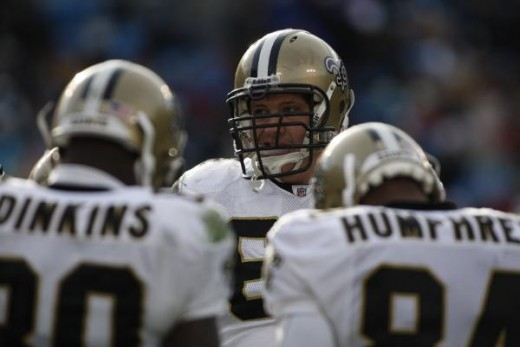 The New Orleans Saints tackle Zach Strief, center, talks to teammates during a break in the action as the Saints play the Carolina Panthers in an NFL football game in Charlotte, N.C., Jan. 3, 2010. Carolina won 23-10.(AP Photo/Nell Redmond)