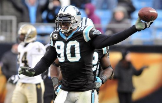 Carolina Panthers' Julius Peppers reacts after recovering a New Orleans Saints fumble in the second half of the Panthers' 23-10 win in an NFL football game in Charlotte, N.C., Sunday, Jan. 3, 2010. (AP Photo/Mike McCarn)