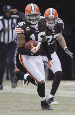 Followed by teammate Nick Sorensen, Cleveland Browns wide receiver Josh Cribbs (16) runs with a kick return against the during pre-game warm ups before their NFL football game Sunday, Jan. 3, 2010, in Cleveland. (AP Photo/Amy Sancetta)