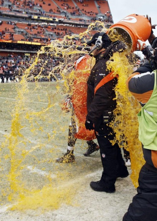 Cleveland Browns coach Eric Mangini gets doused by fullback Lawrence Vickers, not seen, at the end of the Browns' 23-17 win over the Jacksonville Jaguars in an NFL football game Sunday, Jan. 3, 2010, in Cleveland. (AP Photo/Amy Sancetta)