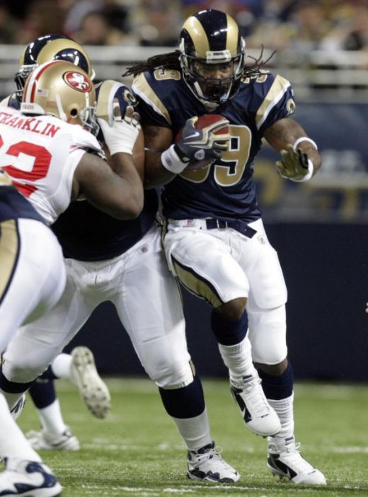 St. Louis Rams running back Steven Jackson, right, runs for a short gain past San Francisco 49ers defensive tackle Aubrayo Franklin, left, during the first quarter of an NFL football game Sunday, Jan. 3, 2010, in St. Louis. (AP Photo/Jeff Roberson)
