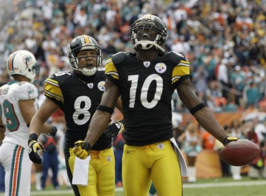Pittsburgh Steelers wide receiver Santonio Holmes (10) celebrates a touchdown with wide receiver Hines Ward (86) during the first half of an NFL football game against the Miami Dolphins, Sunday, Jan. 3, 2010, in Miami. (AP Photo/Lynne Sladky)