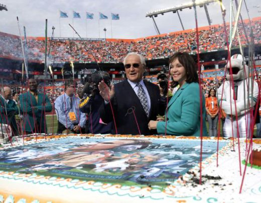 Former Miami Dolphins head coach Don Shula, center, and his wife, Mary Anne, stand near a birthday cake on the field during a celebration for Shula's 80th birthday, which is Monday, during halftime of an NFL football game between the Dolphins and the