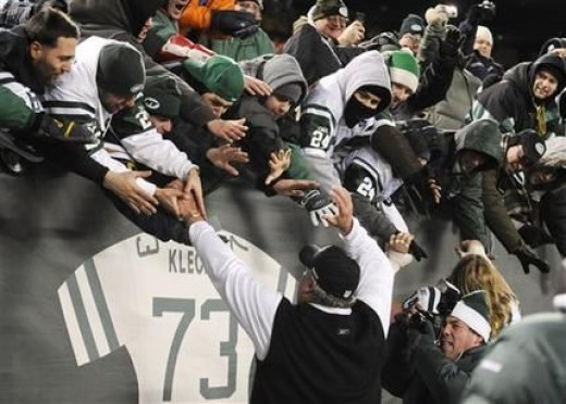 New York Jets head coach Rex Ryan greets fans after the Jets 37-0 win over the Cincinnati Bengals in an NFL football game at Giants Stadium in East Rutherford, N.J., Sunday, Jan. 3, 2010. (AP Photo/Bill Kostroun)
