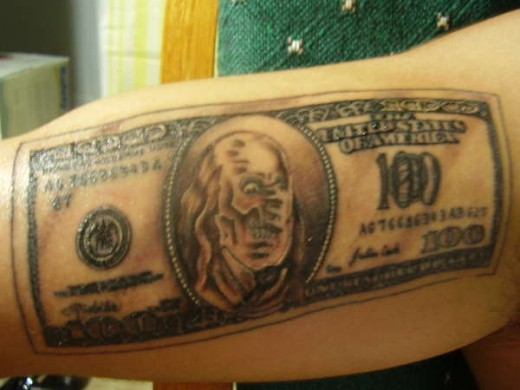 Sell Tattoos To Make Money.  Image taken from http://tattoos-and-art.com/wp-content/gallery/skull-tattoos/hundred-dollar-bill-tattoo-51752.jpg Copyright 2010.