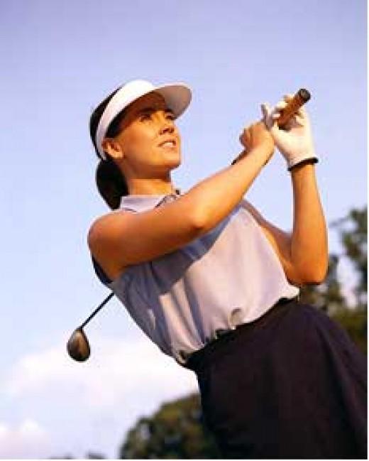 Woman Golfer Starting Her Swing