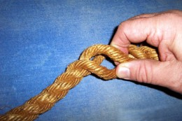 Grasp the rope at the point where you want the end to attach to the shaft of the rope.