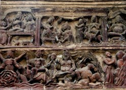 This panel has a mixture of Shaiva motifs as well as Krna Leela. We have an emaciated Shiva with much-naked playful Ganesha in the lower row's centre, flanked by unknown characters. Top left, we find Krsna playing flute , Radha on His left and a 'Man