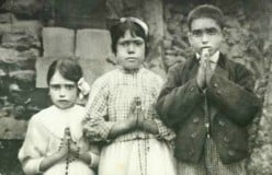Lucia dos Santos and her cousins Francisco Marto and Jacinta Marto in 1917