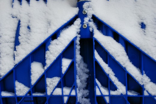 Snow highlights the ribbing of a plastic snow shovel -- that's getting a lot of use now.