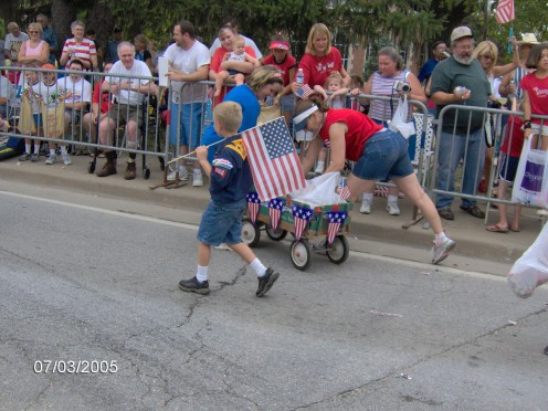 A little boy marching with the US Flag