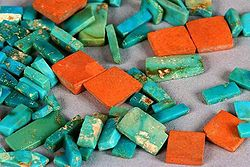 Ancestral Puebloan (Anasazi) turquoise and orange argillite inlay pieces from Chaco Canyon (dated ca. 10201140 CE) show the typical colour range and mottling of American turquoise - from wikimedia.commons