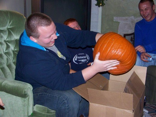 The lucky recipient of the rotten pumpkin in the White Elephant Gift Exchange.