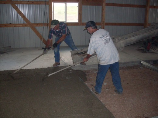 My husband and his co-worker use drags to help apportion and smooth out the cement.
