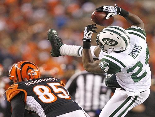 Darrelle Revis picks off a pass in front of Bengals WR Chad Ochocinco in the second quarter.