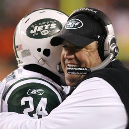 New York Jets head coach Rex Ryan hugs Darrelle Revis at the end of their game. Photo Credit: Rueters