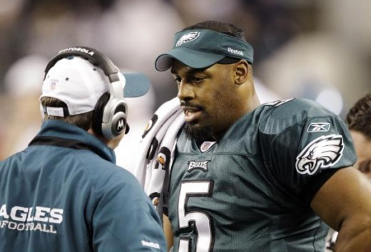 Philadelphia Eagles quarterback Donovan McNabb (5) chats to a staff member on the sideline during an NFL wild-card playoff football game against the Dallas Cowboys, Saturday, Jan. 9, 2010, in Arlington, Texas. (AP Photo/David J. Phillip)