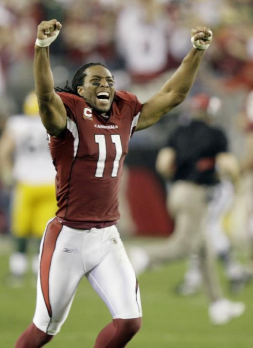 Arizona Cardinals' Larry Fitzgerald celebrates after Arizona defeated the Green Bay Packers 51-45 in overtime in an NFL wild-card playoff football game Sunday, Jan. 10, 2010, in Glendale, Ariz. (AP Photo/Paul Connors)