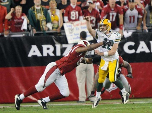 Green Bay Packers quarterback Aaron Rodgers (12) throws under pressure against the Arizona Cardinals at University of Phoenix Stadium in Glendale, Arizona on January 10, 2010. (Kirby Lee/NFL.com)