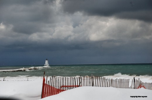 The Ludington North Breakwater Lighthouse on the shores of Lake Michigan plays host to sea gulls as another batch of lake-effect snow clouds roll along the lake. Lake Michigan can produce its own weather, and in Ludington this winter it's been a stea