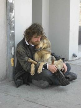 Homeless man with pet dog