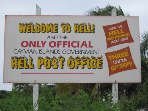 Sign in parking lot of Official Hell Government Post Office
