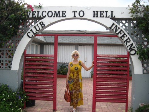 My wife at entrance to Club Inferno in town of Hell, Grand Cayman Island