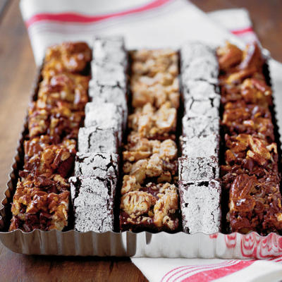 Delicious fudge brownies, nut-crusted or dusted with icing sugar - southernliving.com