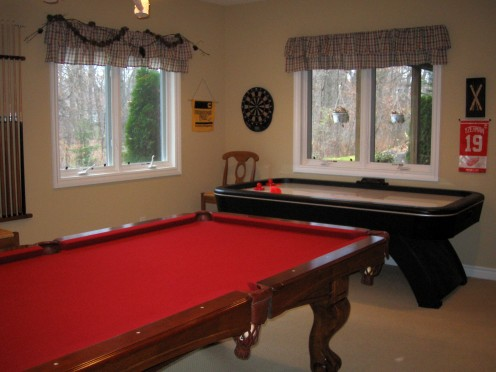Make game room large enough to fit game tables and appropriate playing area.