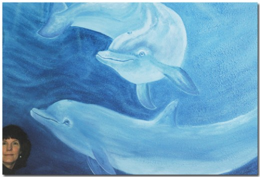 Dolphins painted on a wall at High Mesa Healing Center