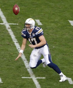 The ball goes over San Diego Chargers quarterback Philip Rivers on a botched snap in the first half of an NFL divisional playoff football game against the New York Jets, Sunday, Jan. 17, 2010, in San Diego. Rivers recovered the ball for a loss. (AP P