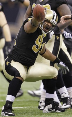 New Orleans Saints defensive end Will Smith (91) reacts after intercepting a pass from Arizona Cardinals quarterback Kurt Warner during the second quarter of an NFL football divisional playoff game in New Orleans, Saturday, Jan. 16, 2010. (AP Photo/D