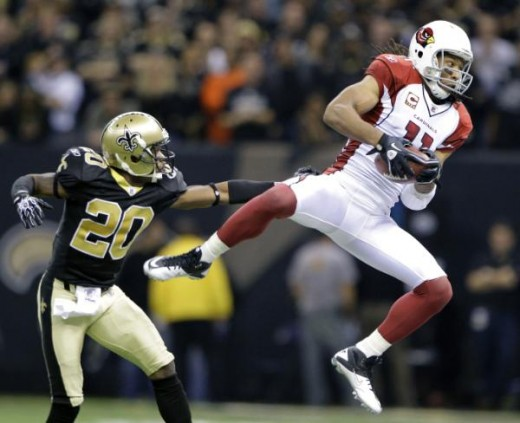 Arizona Cardinals wide receiver Larry Fitzgerald (11) catches a pass with New Orleans Saints cornerback Randall Gay (20) defending during the second quarter of an NFL football divisional playoff game in New Orleans, Saturday, Jan. 16, 2010. (AP Photo