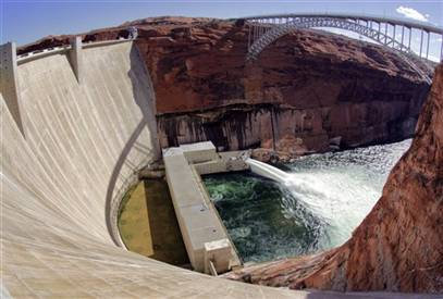 Water being released at a major force from the bottom of the Glen Canyon Dam.
