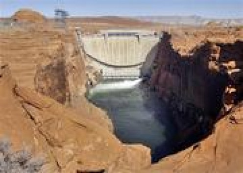 Spanning the distance of the canyon walls, is the Glen Canyon Dam.