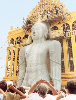 Gomateshwara-one of the gods worshipped by Jains.His large monolithic idol at Shravanabelagola-During the great head-bathing ceremony conducted once in 12 years.