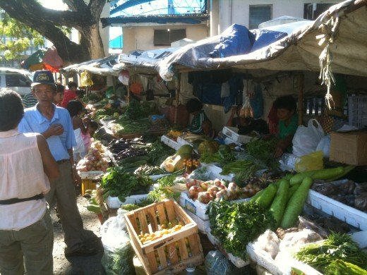 Shy Vendor at public market in Olongapo Philippines