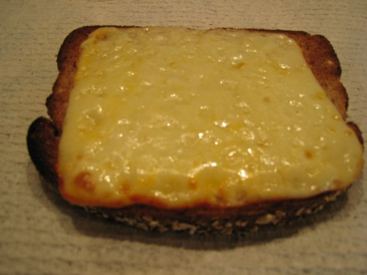 Tasty cheese on toast.    Image taken from http://snacktime.files.wordpress.com copyright 2010.