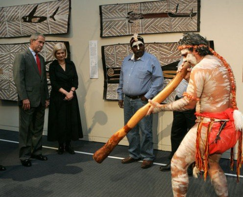 President George W. Bush at a performance of Aboriginal song and dance 9/6/2007 at the Australian National Maritime Museum, Sydney. The performer to the right is playing a traditional diggeridoo.