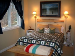 Guest room bed with faux headboard.