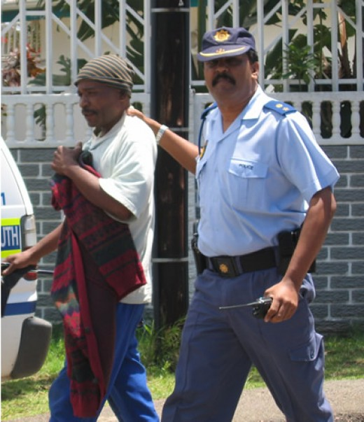 Remember the days of Apartheid. The more things change the more they stay the same, if not worse. A protester being led away by a cop.