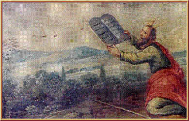 The above is a painting on wood drawer from furniture kept at the Earls DOltremond, Belgium. Moses is receiving the tablets and several objects in the sky are seen near by. Date and artist unknown.