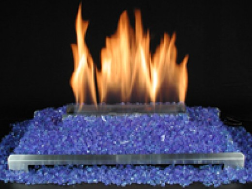 Fireplaces with crushed glass are becoming more popular for the modern home with contemporary decor.  This ventless gas log fireplace has a stainless burner and crushed blue glass.
