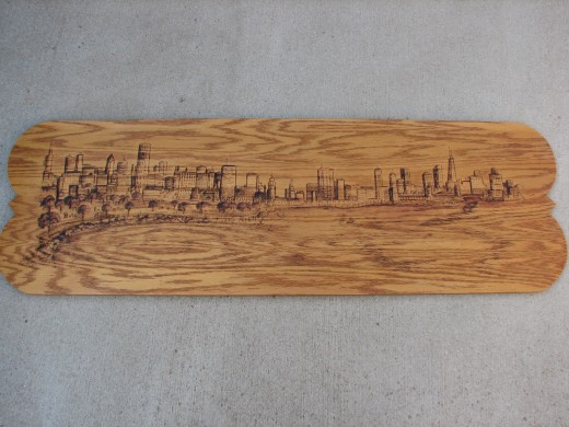 This work measures 4ft x 18in pyrographics on stained oak wood  panel