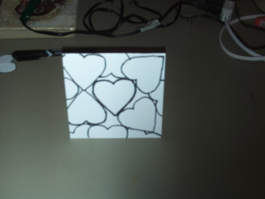 Here I have created the montage by tracing the heart shapes all around the the front of the card.