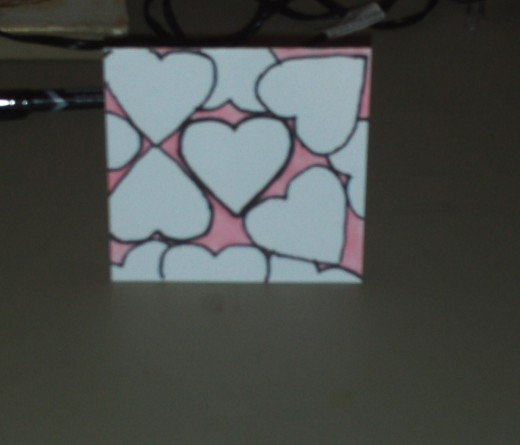 I decided to add pink color in between all of the heart shapes on the card.